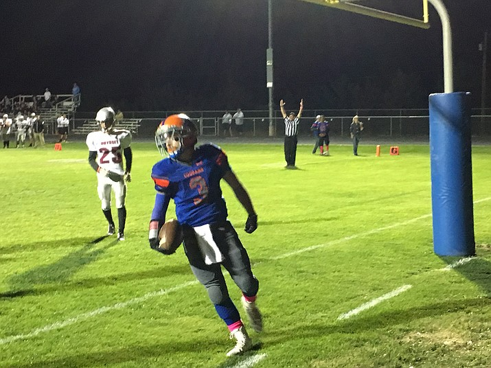 Chino Valley sophomore Michael Paulus scores the first touchdown in a 48-28 victory against Odyssey Institute on Friday, Oct. 28 in Chino Valley.