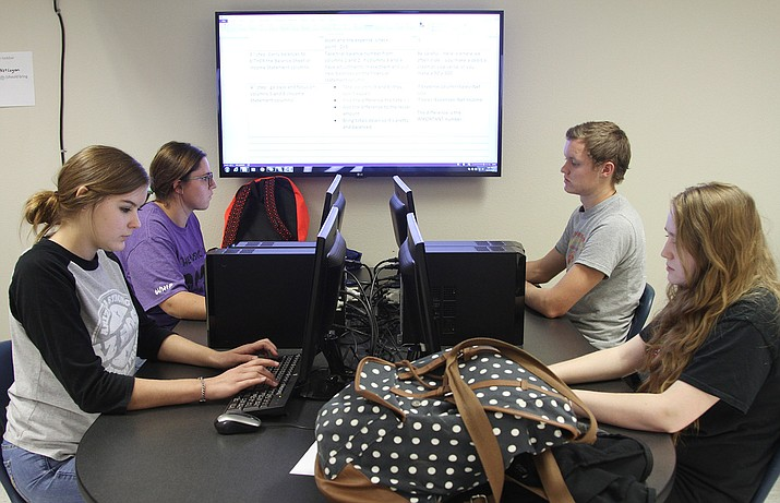 From left to right, Serenity Lynch, Delanie Cencelewski, Scotty Winder and Michelle Thomas study in a sophomore through senior Accounting Class of Business Management and Administrative Services at Kingman High School in October.
