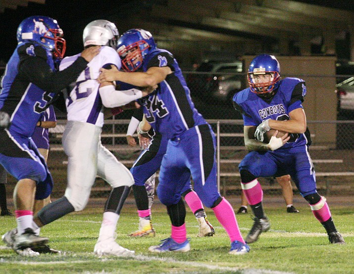 Camp Verde running back Ryan Cain runs upfield in Camp Verde's 12-8 win Friday at home against Sedona-Red Rock High School. (Photo by Bill Helm)