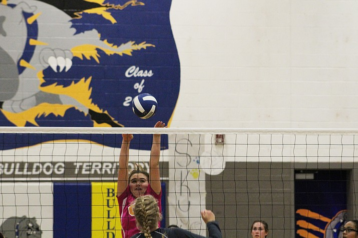 Kingman's Keegan Geeser goes up for a block in the Lady Bulldogs' three sets to two win over River Valley Thursday. It was the last match of the season, and Kingman's first win.