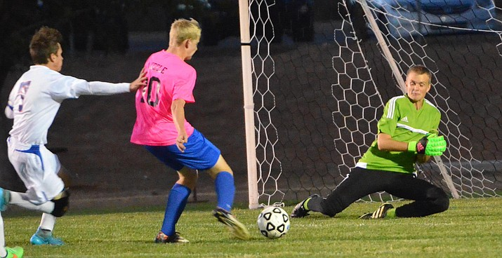 Camp Verde goalie Preston Maynard was crucial to the Cowboys' win over Show Low Friday as he made stop after stop to keep his team in the game.  Maynard put in work keeping the Cowboys from going down by stopping several shots on goal and none more crucial than in the last 10 seconds when Cougars were trailing by one goal and put an all-out assault on him to score a goal with five seconds left in the game, only to be called for touching the ball. (VVN/Vyto Starinskas)