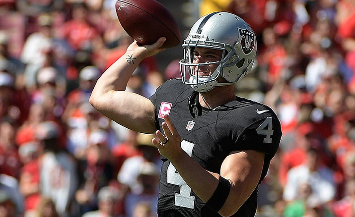 Oakland Raiders quarterback Derek Carr throws a pass against the Tampa Bay Buccaneers during the first quarter of an NFL football game Sunday, Oct. 30, in Tampa, Fla.