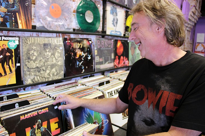 Daryl Halleck sifts through some of the vinyl he stocks in his record store, Trax Records.
