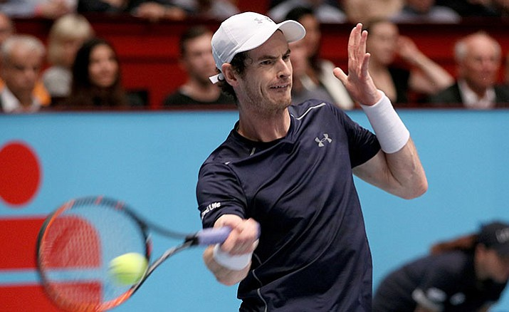 Andy Murray of Great Britain returns the ball to Jo-Wilfried Tsonga of France during their final match at the Erste Bank Open tennis tournament in Vienna, Austria, Sunday, Oct. 30.