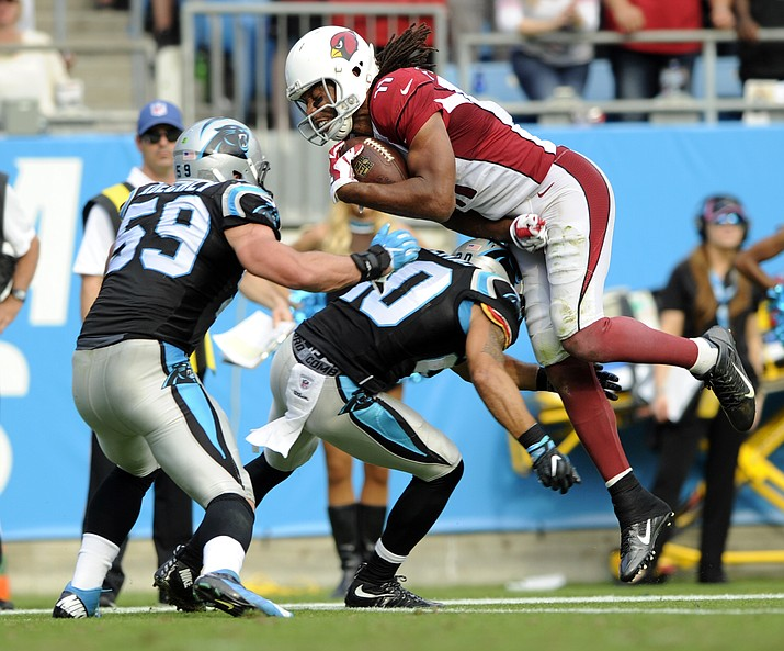 Arizona Cardinals' Larry Fitzgerald is upended by Carolina Panthers' Kurt Coleman (20) in the second half of an NFL football game in Charlotte, N.C., Sunday, Oct. 30.