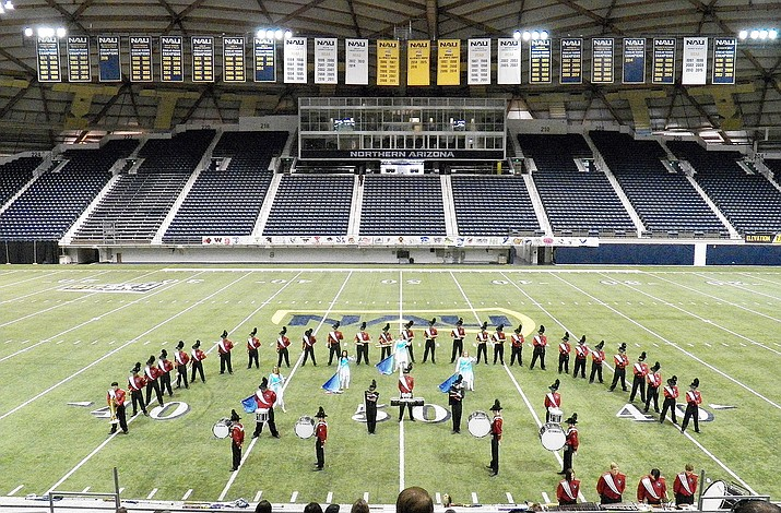 The Lee Williams High marching band performs at Northern Arizona University in Flagstaff on Saturday.
