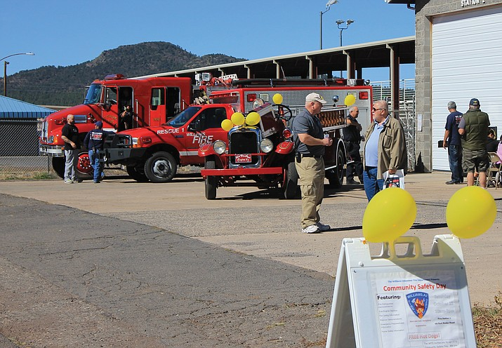 A CodeRED system by the city of Williams and Coconino County notifies residents of disasters and other emergencies. Right: Williams residents come together for a community safety event Oct. 22.