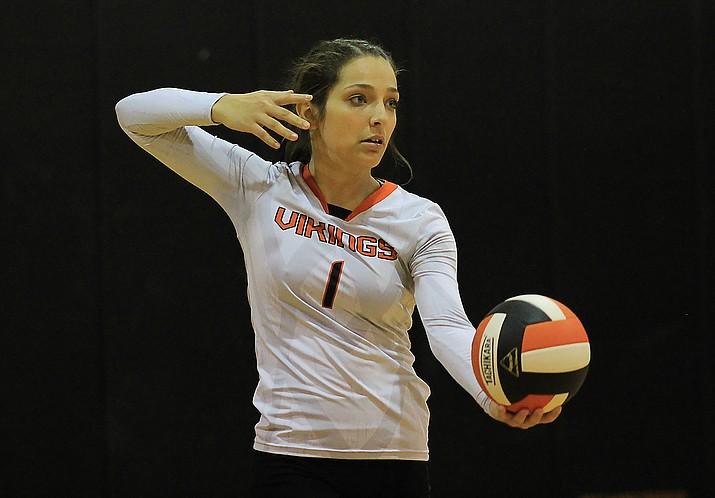 Viking Paige Kmetz serves the ball.