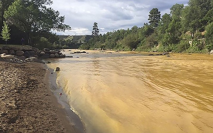 The Animas River ran yellow with toxin-tainted water last August after the accidental release of 3 million gallons of wastewater from the abandoned Gold King Mine near Durango, Colorado. Photo courtesy Colorado Parks and Wildlife Department