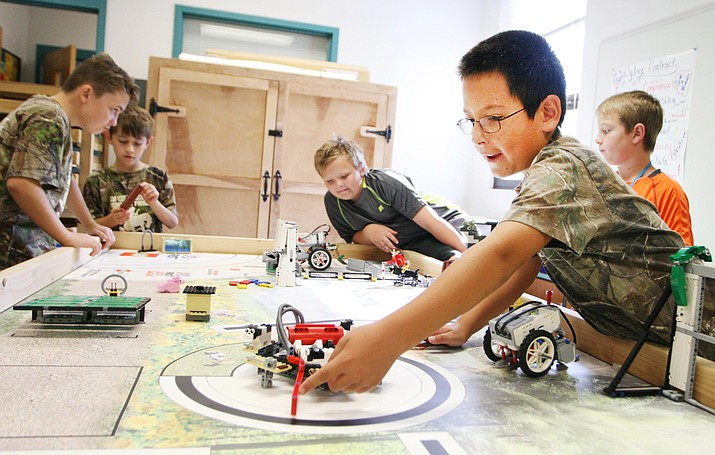 Students in Camp Verde Elementary School's Robotics Program spend a recent Friday morning preparing for the Flagstaff regionals of the First Lego League's Animal Allies national robotics competition, scheduled for Dec. 3. (Photo by Bill Helm)