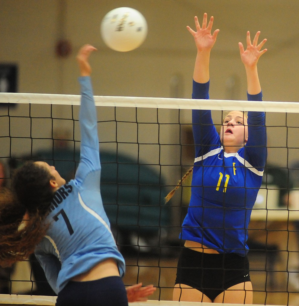Prescott's Alex Koehler goes for a block as the Lady Badgers take on Pueblo Magnet in the first round of the Arizona Interscholastic Association State Volleyball Tournament in Prescott Wednesday, Nov. 2.