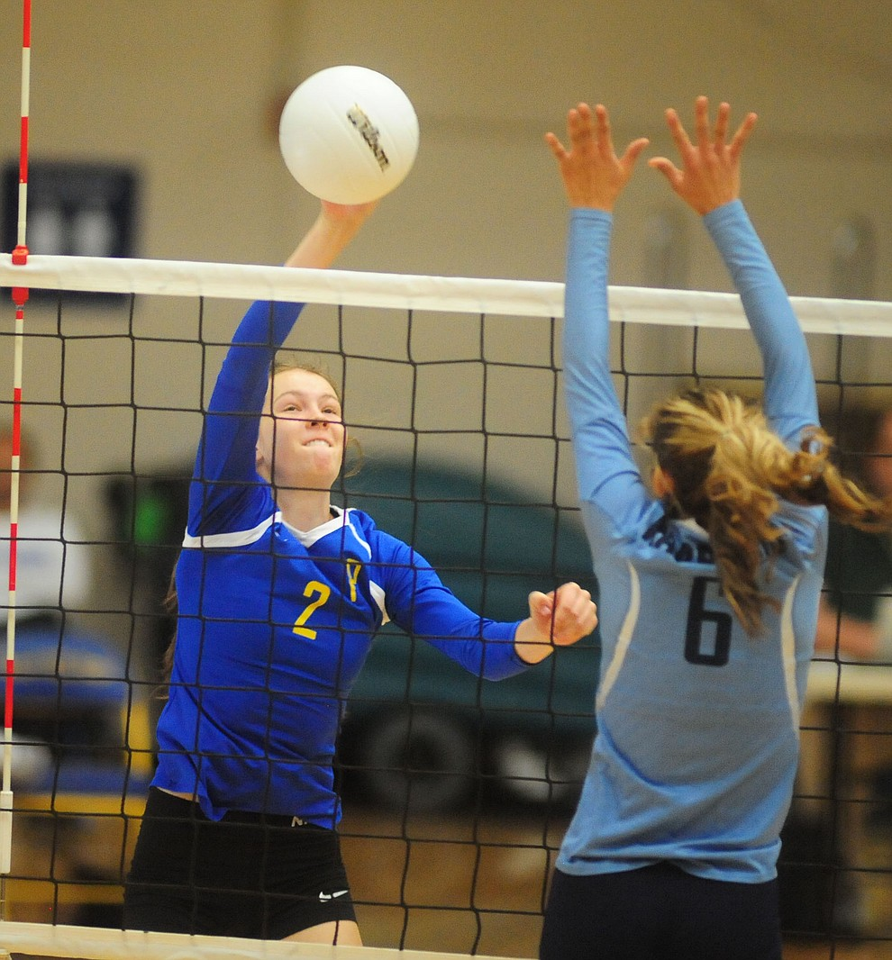 Prescott's Dani Dreher goes for a kill as the Lady Badgers take on Pueblo Magnet in the first round of the Arizona Interscholastic Association State Volleyball Tournament in Prescott Wednesday, Nov. 2.
