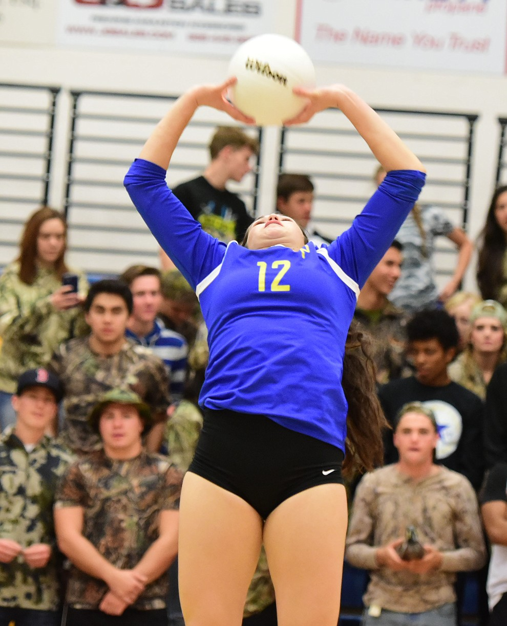 Prescott's Erinn Marroquinn sets the ball as the Lady Badgers take on Pueblo Magnet in the first round of the Arizona Interscholastic Association State Volleyball Tournament in Prescott Wednesday, Nov. 2.