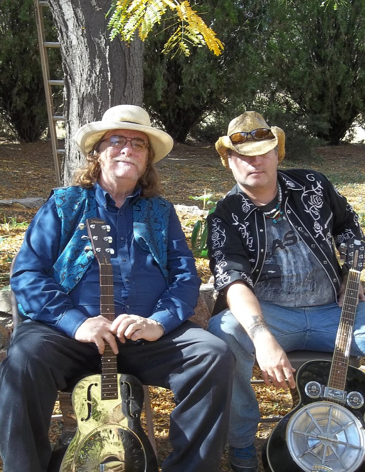 Christian Michael Berry and Don Whitcher pose with their instruments