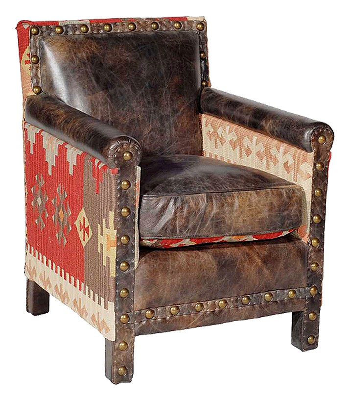 This undated photo provided by Houseology shows the Marlborough chair from Andrew Martin, which combines distressed leather and kilim upholstery – two up-to-the-minute material trends – with a traditional chair style to create something thoroughly modern. (Andrew Martin/Houseology via AP)