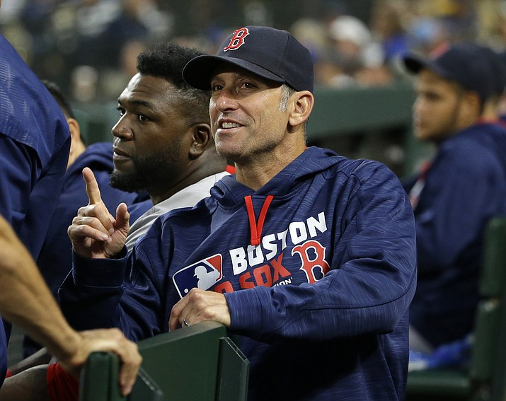 In this Aug. 2 file photo, Boston Red Sox bench coach Torey Lovullo gestures during the sixth inning of a baseball game against the Seattle Mariners, in Seattle. The Arizona Diamondbacks are hiring Boston Red Sox bench coach Torey Lovullo as their manager.