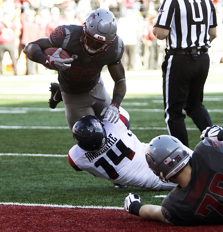 Washington State running back James Williams (32) runs for a touchdown while defended by Arizona linebacker Paul Magloire Jr. (14) during the first half of an NCAA college football game in Pullman, Wash., Saturday.