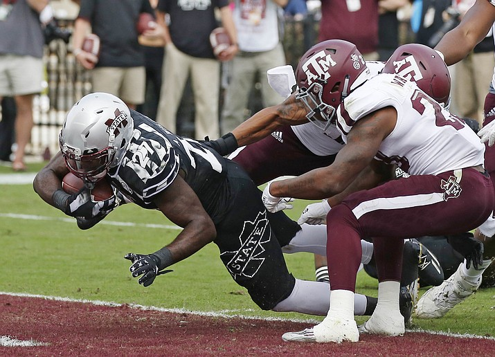 Mississippi State running back Aeris Williams (27) dives into the end zone for a two-yard touchdown run against Texas A&M in the first half of an NCAA college football game in Starkville, Miss., Saturday.