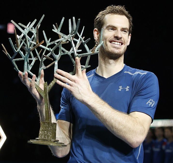 Britain's Andy Murray holds the trophy after winning the final of the Paris Masters tennis tournament against John Isner of the United States in three sets at the Bercy Arena in Paris, Sunday, Nov. 6.