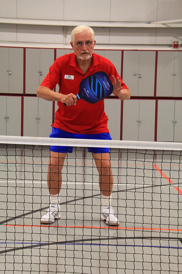 "Part of the basic strategy behind the game of Pickleball is playing ""paddle up,"" such as above and as opposed to below. It works to protect you, provides a positive mental state, and keeps you at the ready for the next shot."