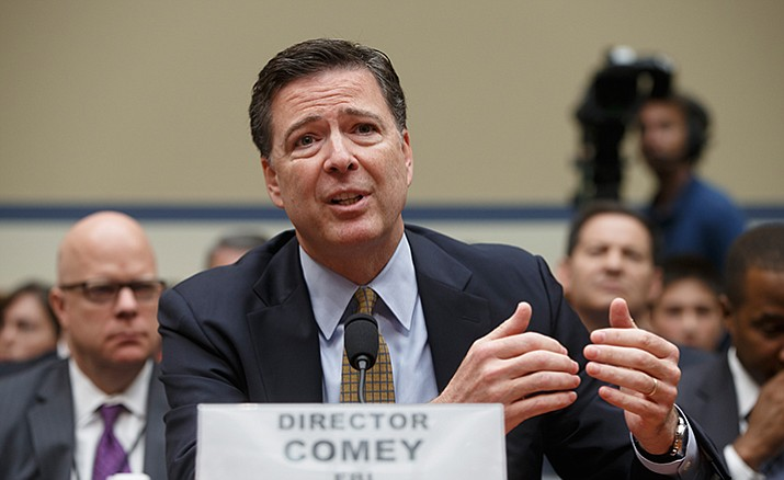 In this July 7, 2016 file photo, FBI Director James Comey testifies on Capitol Hill in Washington before the House Oversight Committee to explain his agency's recommendation to not prosecute Hillary Clinton. In a letter from Comey released on Nov. 6, he tells Congress review of additional Clinton emails does not change conclusion she should not face charges.