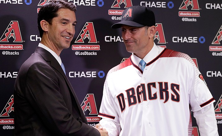 New Arizona Diamondbacks manager Torey Lovullo, right, is greeted by Diamondbacks' Executive Vice President and General Manager Mike Hazenor during an introductory press conference Monday, Nov. 7, at Chase Field in Phoenix.