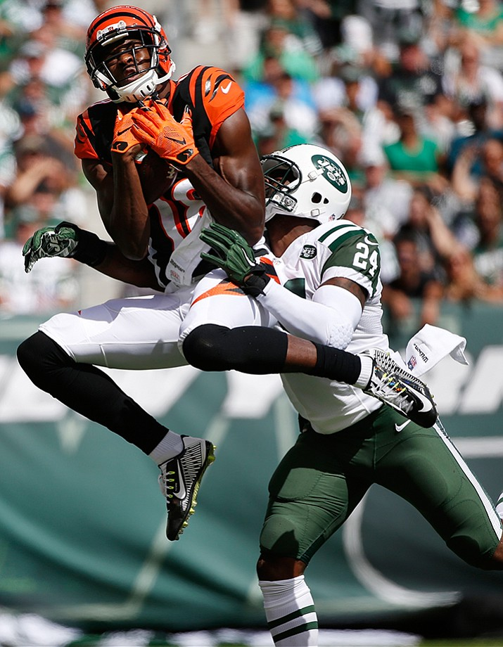 Cincinnati Bengals' A.J. Green catches a pass in front of New York Jets' Darrelle Revis during their Sept. 11 NFL football game, in East Rutherford, N.J. Green was leading the NFL in receptions when Cincinnati went on its bye despite being the focus of opposing defenses on every passing play.