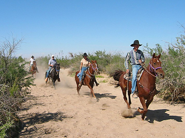 Horseback riding is one of the more popular activities that draw visitors to the Stagecoach Trails Guest Ranch in Yucca. The Mohave County Board of Supervisors on Monday approved a zoning change that will allow for a shooting range at the ranch. Wagon rides are also popular.
