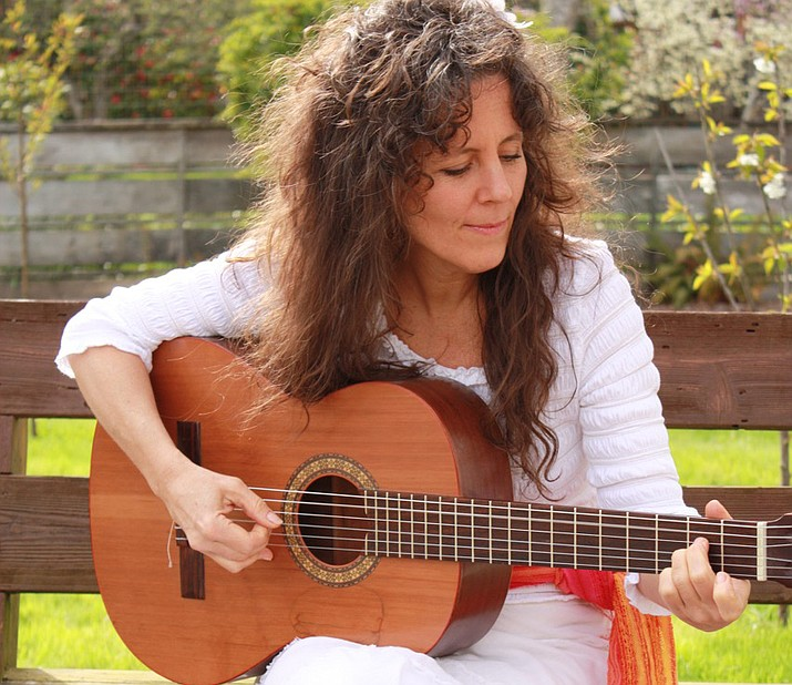 Gina Machovina is best known for her virtuoso guitar playing and smooth, sultry vocals.