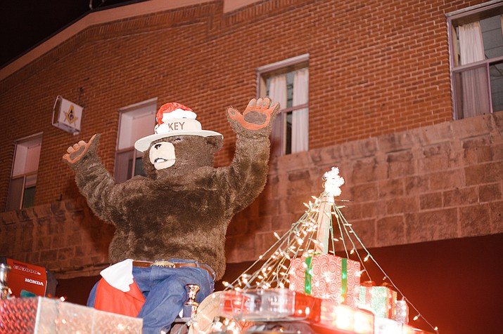 Smokey the Bear rides on a float in the 2014 Christmas Parade in Williams.