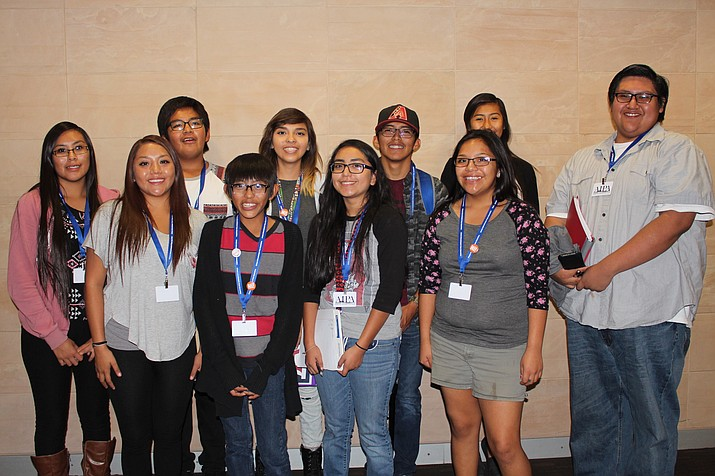 "Hopi High media students were all smiles at the Arizona Interscholastic Press Association Conference. They are, from left, Breanna Saufkie, Janissa ""eeesa"" Lahaleon, Issac Talas-Lomayaktewa, Diondre Onsae, Serena Leslie, Elisa ""Mouth"" Casares, Kyle Secakuku, Amber Polacca, Krista ""Double K"" Koyaquaptewa and Ronald Lopez. Photo/Stan Bindell"