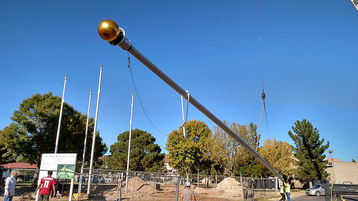 D&O Crane installs the 70-foot American flagpole at the Verde Valley Military Park. The ribbon-cutting ceremony is scheduled for Nov. 11 at 1 p.m. at Garrison Park. (Courtesy of Richard Faust)