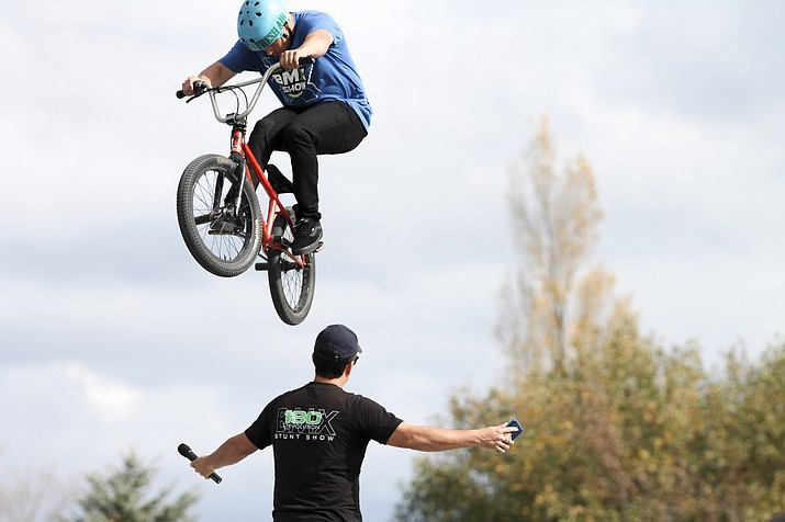Wheels of Freestyle BMX rider Zury Brambila jumps over announcer Luis Hoyos during a drug prevention program at Williams Elementary-Middle School Nov. 3.