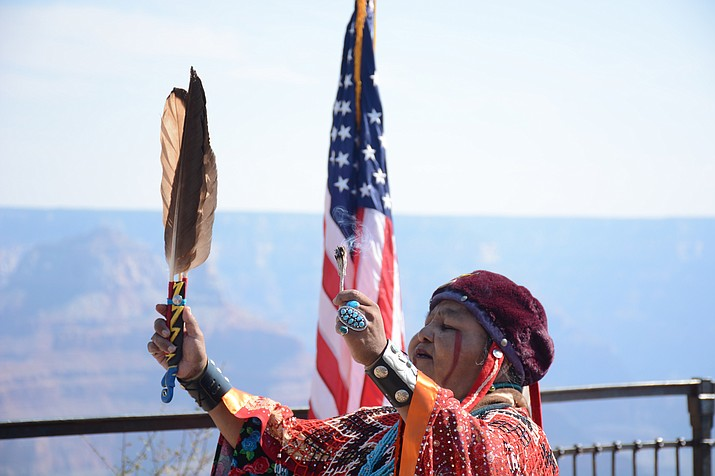 A member of the Havasupai Tribe performs a traditional ritual during a naturalization ceremony in August at Grand Canyon National Park. Photo/Bri Cossavella, Cronkite News