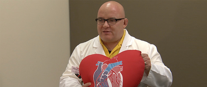 Yavapai Regional Medical Center cardiovascular surgeon, Dr. Jose Torres, shows off the heart pillow