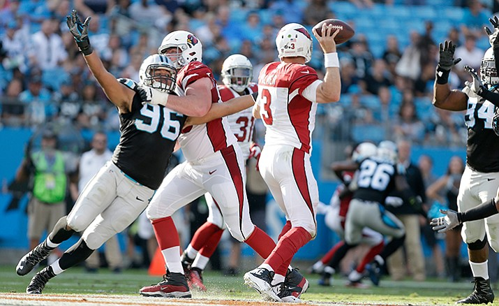 Carolina Panthers' Wes Horton tries to stretch out of the block to get to Arizona Cardinals' Carson Palmer during the second half of a game in Charlotte, N.C., Sunday, Oct. 30. The Panthers won 30-20.