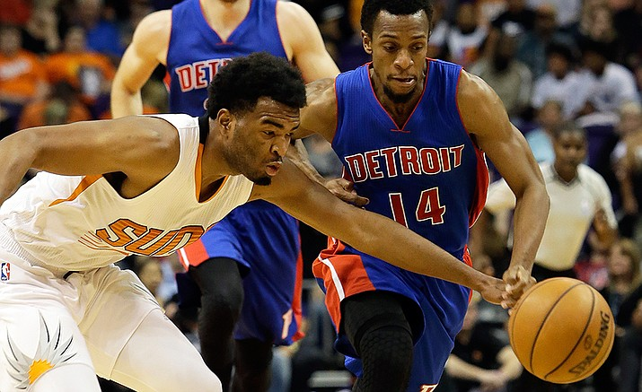 Phoenix Suns forward Marquese Chriss and Detroit Pistons guard Ish Smith battle for the loose ball in the first quarter during an NBA basketball game against, Wednesday, Nov. 9, in Phoenix.