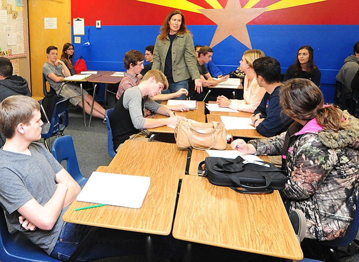 Teacher Brenda Lee talks to students about their reactions to the results during a Presidential Election recap in the senior government class at Prescott High School Wednesday, Nov. 9.