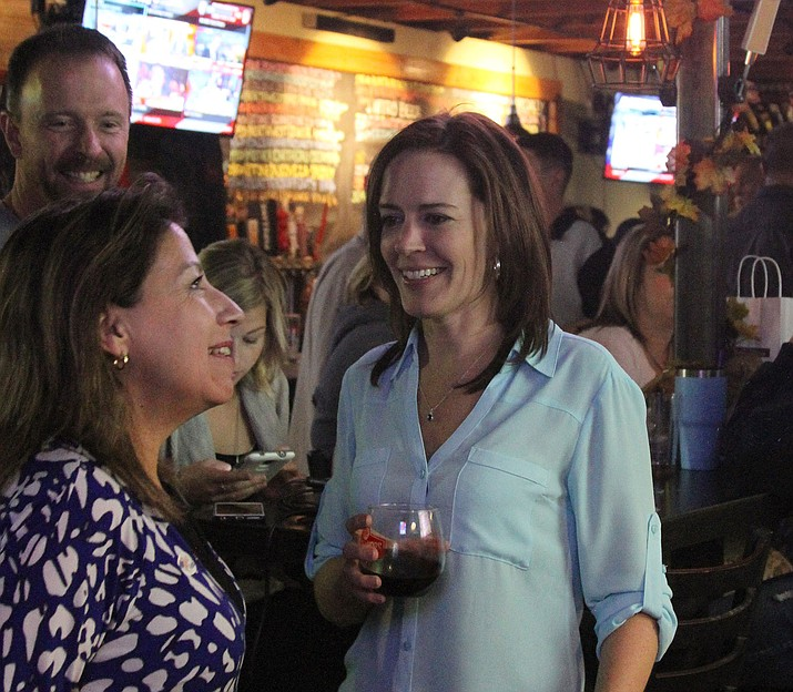 Mayor-elect Monica Gates (left) celebrated her return to office with friends Tuesday night at House of Hops.