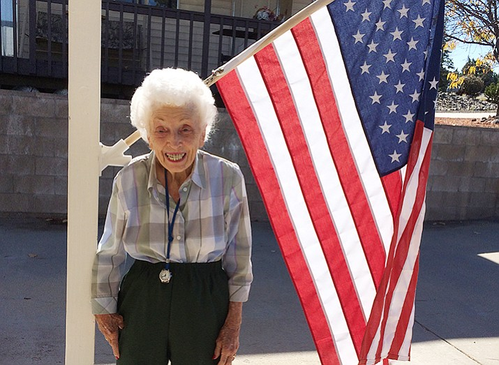 Jerry Emmett, 102, in front of the American flag she puts in its holder every morning at her Prescott home. Emmett's first presidential vote was in 1933 for Franklin Delano Roosevelt.