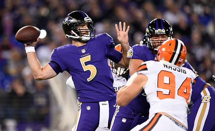 Baltimore Ravens quarterback Joe Flacco winds up for a throw during the first half the team's NFL football game against the Cleveland Browns, Thursday, Nov. 10, in Baltimore.