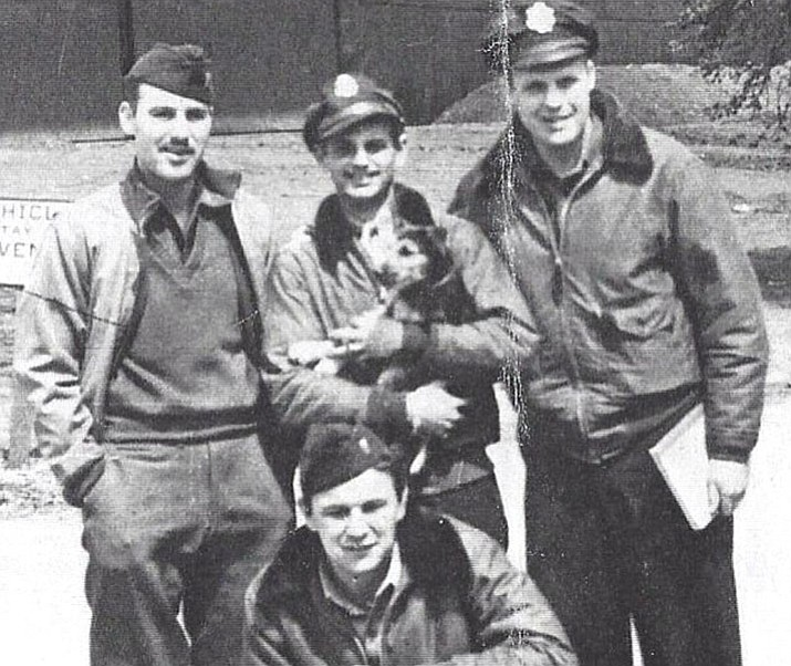 Dave Hamilton, center, holding a dog, is related to Founding Father Alexander Hamilton. He also is the last surviving Pathfinder pilot from D-Day in World War II.