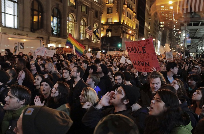 Protesters chant slogans on Fifth Avenue outside Trump Tower, Wednesday, Nov. 9, 2016, in New York, in opposition of Donald Trump's presidential election victory.