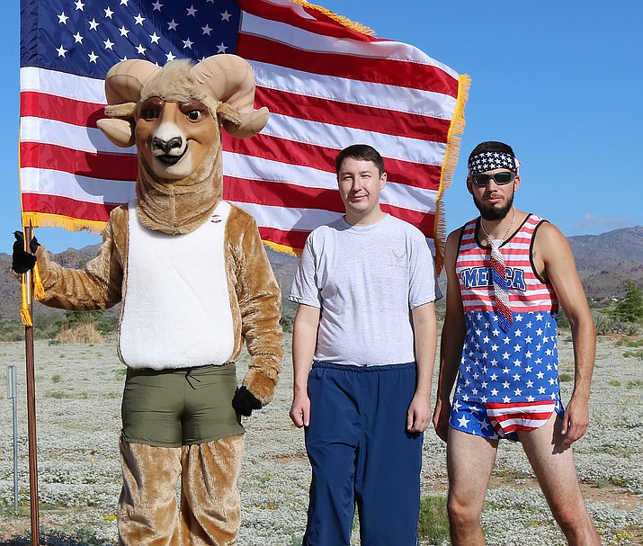 From left to right, Boomer, MCC's bighorn sheep mascot, Veterans Club Vice President Ronald Marcks and Veterans Club President Reyes Lerma after a previous hike.