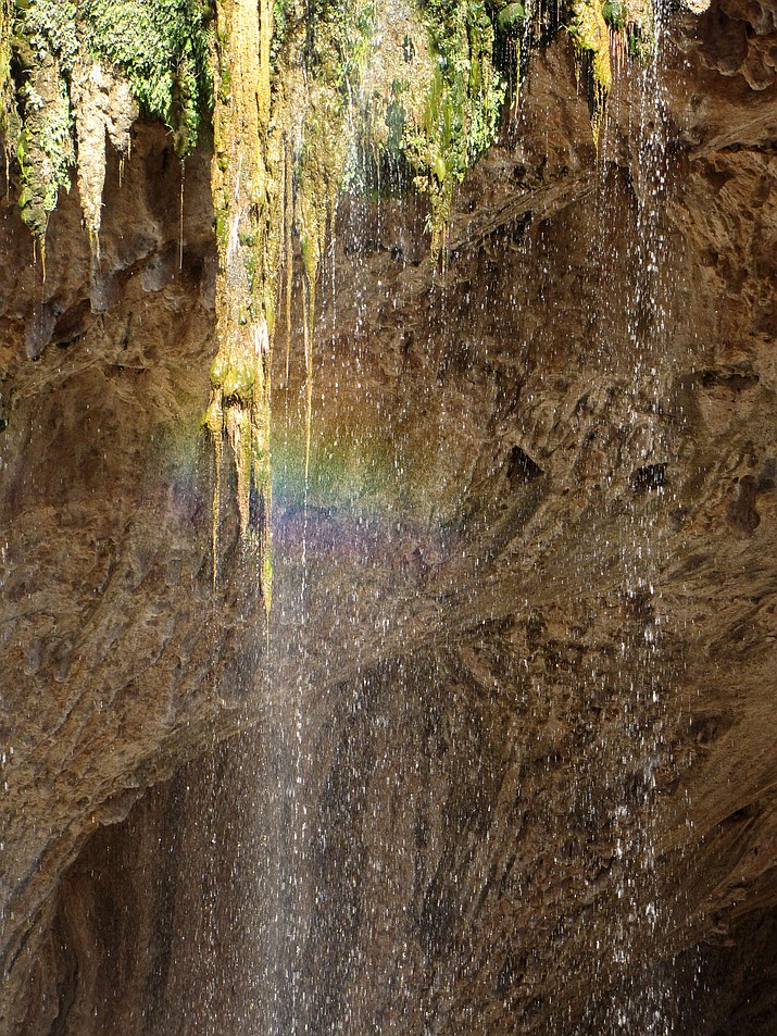 Rainbow shimmers within waterfall over Tonto Natural Bridge. (Melissa Bowersock)