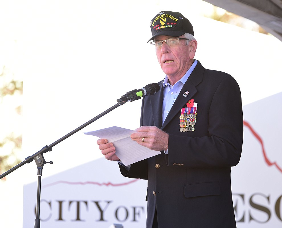 Mayor Harry Oberg opens the ceremony as crowds lined the streets as the 2016 Veterans Day Parade winds through the streets of downtown Prescott Friday morning. The parade featured over 90 entries.