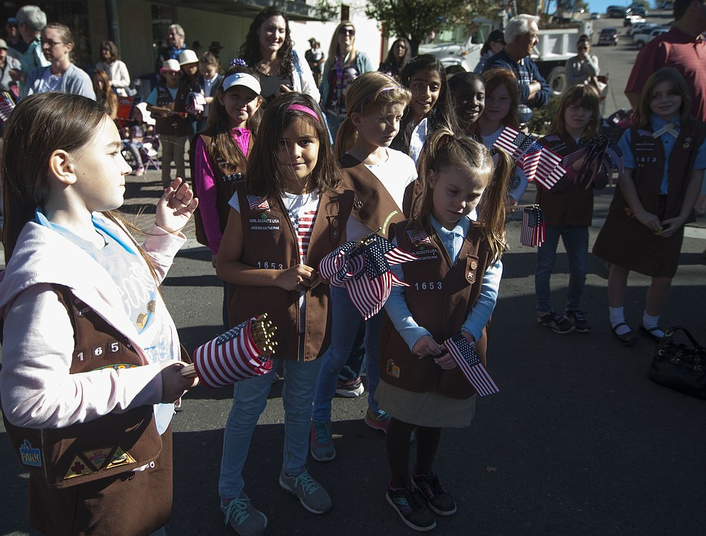 Basis Brownies Tropp 1653 handed out cards and flags to people as crowds lined the streets as the 2016 Veterans Day Parade winds through the streets of downtown Prescott Friday morning. The parade featured over 90 entries.