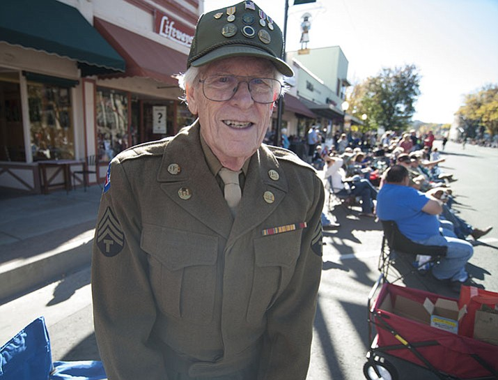 World War II Army Photographer Len Borok stands as crowds lined the streets for the 2016 Veterans Day Parade through the streets of downtown Prescott that featured over 90 entries.