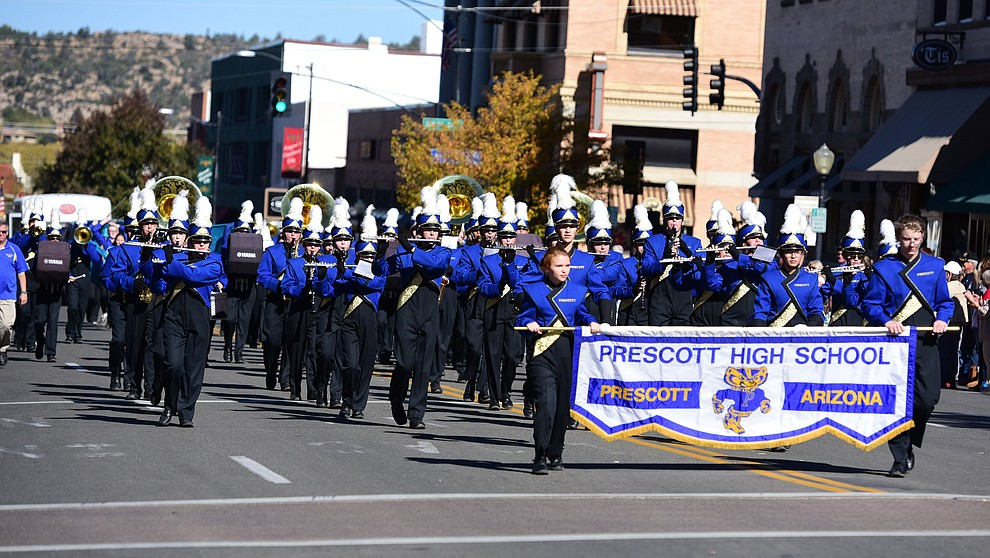 The Prescott High School Marching Band performs as crowds lined the streets as the 2016 Veterans Day Parade winds through the streets of downtown Prescott Friday morning. The parade featured over 90 entries.