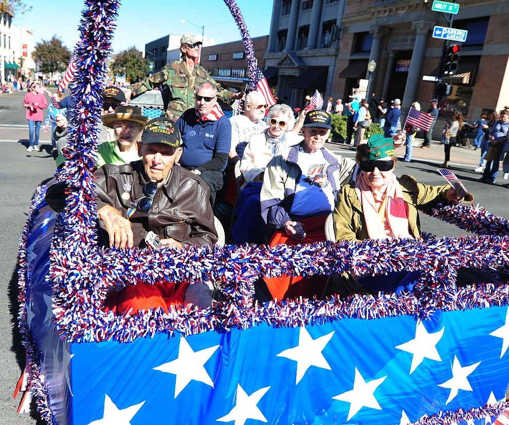 Crowds lined the streets as the 2016 Veterans Day Parade winds through the streets of downtown Prescott Friday morning. The parade featured over 90 entries.